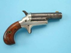 Colt Third Model Derringer -- They were also not too small, but smaller than revolvers