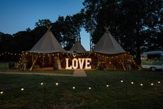 A tipi lit up at night at a wedding at Pipewell Hall in Northants in Northamptonshire. Photos by Sarah Vivienne Photography Wedding marquees and tipi venues for a boho festival outdoor wedding Tipi Wedding, Inexpensive Wedding Venues, Marquee Wedding, Wedding Events, Destination Wedding, Wedding Halls, Wedding Ideas, Wedding Affordable, Wedding Venues Uk