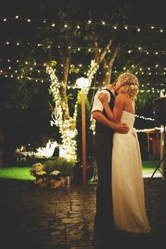 Love the lights hanging above and wrapped around the trees. And I want a dancefloor like this for my outdoor wedding