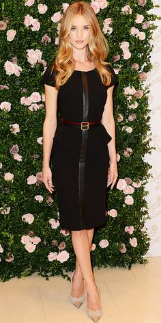 Rosie Huntington-Whiteley launched her Rosie for Autograph lingerie collection in a black peplum dress and cap-toe pumps, August 30, 2012.