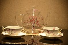 Clear glass tea pot with beautiful cherry blossom design.