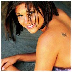 Female Tattoos Designs Small Flower Design Tattoos For Beautiful Women - http://www.listtattoo.com/female-tattoos-designs-small-flower-design-tattoos-for-beautiful-women/?Pinterest