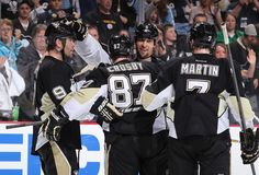 Crosby, Martin, and Engelland celebrate Pascal Dupuis's second period goal against New Jersey 3/25/12