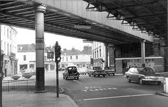 Looking towards Banbury this view of the junction of Bath Street and High Street shows the former LNWR and GWR bridges before demolition of the former bridge occurred in 1960