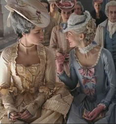 Marie Antoinette and The Princesse De Lamballe joking at an elderly woman nodding off in the back rows.