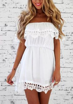 Front view of model in white off shoulder dress