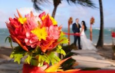 Great color contrast with the bouquet and sea. Great bouquet ideas for destination weddings.