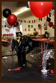 Red, black, and white balloons and pirate flags.