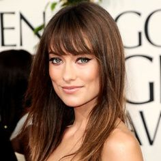 Olivia Wilde's Airy Bangs    WHY IT WORKS Wilde has a strong jaw, which is softened by the wispy, face-framing layers. Long, airy bangs draw attention to the eyes. HOW TO GET IT Ask for eyebrow-grazing bangs that are tapered at the corners, and angled layers starting from the chin down.