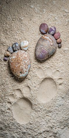 Footprints in the Sand by Iain Blake Footprints In The Sand, Baby Footprints, Pebble Stone, Stone Art, Pebble Art Family, Dream Catcher Craft, Glass Rocks, Pebble Pictures, Rock Design