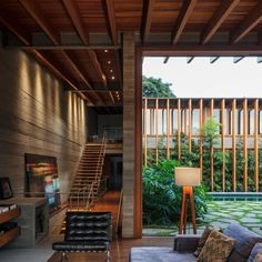 Image 3 of 21 from gallery of Poa House / Bernardes Arquitetura. Photograph by Leonardo Finotti Indoor Outdoor Living, Outdoor Decor, Smooth Concrete, Wooden Staircases, House Deck, Timber House, Color Tile, Architecture Photo, Grey Walls