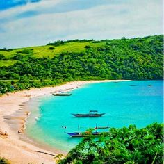 Calaguas Island, Philippines has white fine sand and calm clear blue waters... there are no hotels or restaurants. It's nature at its best. The beach is surrounded by lush green vegetation.