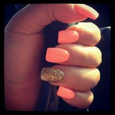 Bright coral nails with a touch of glitter. Perfect for spring or summer!