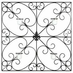 """Iron candle wall decor with a scrolling design.   Product: Candle wall decorConstruction Material: Iron and glassColor: BlackFeatures: Scrolling designMade in IndiaPowder coatedAccommodates: (4) Votive candles - not includedDimensions: 28.3"""" H x 28.3"""" W x 3.9"""" D"""