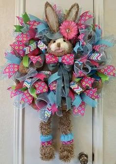 Special Order Item: This wreath can be decorated in any color you like. The Rabbit head comes in three colors, Pink, Green, and Blue. The wreath will delight your family and friends and you will be the envy of everyone!  The following describes the wreath done in pinks and greens. The color choices are endless....This Dapper Rabbit Easter Wreath is not only for Easter, but can be used for the spring season. He is all dressed up and ready to come stay at your house. This Handsome Wreath is…