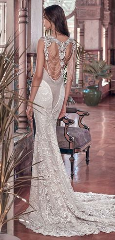 Galia Lahav 2018 mermaid column gown with a sheer back - A mermaid column gown with a sheer back feature made of glistening French Guipure lace, bejeweled with Victorian embroideries and crystal strands on the back.