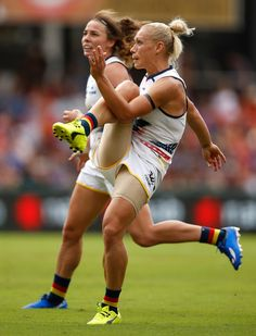 Erin Phillips of the Crows in action during the 2017 AFLW Grand Final match between the Brisbane Lions and the Adelaide Crows at Metricon Stadium on March 2017 in Gold Coast, Australia. Athlete Problems, Cheerleader Images, Australian Football, Gymnastics Photography, Female Athletes, Women Athletes, Beautiful Athletes, Sporty Girls, Love Fitness