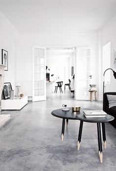 Don't love the cold industrial feel but do love the white black gray balance here. And minimalist decorating.