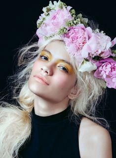 The Inspiring Story Behind The Flower Crowns Taking Over Instagram #refinery29  http://www.refinery29.com/2016/11/128735/ukrainian-flower-crowns#slide-11  The perfect accessories to complement an all-white crown? Raven hair and bold brows....