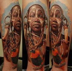 African Village Woman Tattoo On Leg