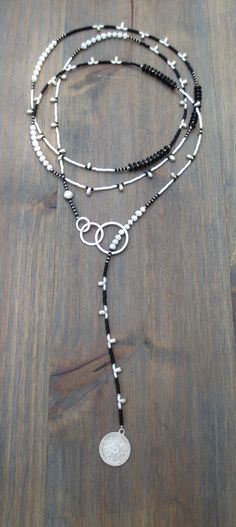 lariat in black, white & silver with Miyuki seedbeads, wooden beads, glass beads & bohemian stamped charm. *Each lariat comes with our clip bead