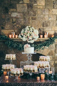 wedding dessert bar- i love the all clear stands with fancy cupcake holders!