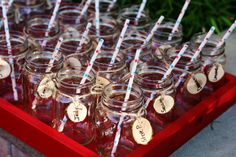 Guests arrived and picked up their handled Mason Jar with Paper Straw and Juniper 'Slice' nametag to use with the cocktails