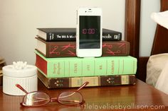 I am happy to share with you the newest addition to our bedroom makeover:         A book iPhone dock.     There are SO many iPhone dock...