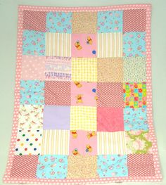 Girl-Teddy Bear Cakes  Handmade Irish Patchwork Quilt & Card.  Child's name & date of birth is Hand-Stitched to add that personal touch.  Includes free baby theme gift bag.  100% Cotton Fabric  2oz Polyester Wadding  Measuring approx 32″ inches (82cm) wide & 44″ inches (112cm) long