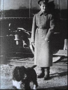 Tsarevich Alexei and his dog Joy outside the Imperial train: c. 1915.