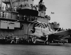 "The motion of its propellers causes an ""aura"" to form around this F6F-3 Hellcat on USS Yorktown (CV-10) 1943."