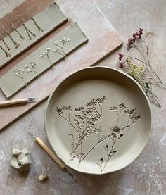 May Share: Top 15 Pins - printed clay plates with dried flowers - Chloe Dominik. May Share: Top Pottery Plates, Slab Pottery, Ceramic Plates, Ceramic Pottery, Pottery Art, Ceramic Art, Thrown Pottery, Clay Plates, Porcelain Ceramics