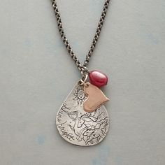 """FOLLOW YOUR HEART NECKLACE--Jes MaHarry shines her artistic light on a sterling silver pendant, etching """"""""follow your heart"""""""" on the back. 14kt rose gold heart and ruby accent"""