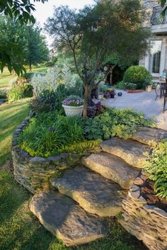 Rough, rounded steps to link a patio to a lower garden for a natural feel.