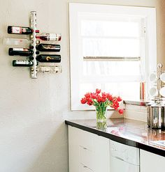 This handy wall-mounted wine rack turns small, unused wall space into hardworking storage. Myhomeideas.com