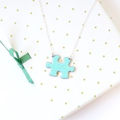 A personal favourite from my Etsy shop https://www.etsy.com/uk/listing/264265101/turquoise-puzzle-necklace-puzzle-piece