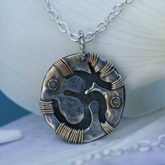 Sterling and Copper Circle Om Pendant Necklace 3/4 inch