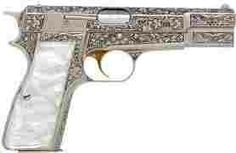 Intricate scroll worked chrome handgun with pearl grip