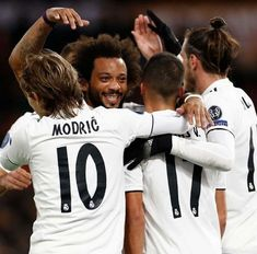 The players of Real Madrid celebrate after scoring during the UEFA Champions League between AS Roma and Real Madrid at Stadio Olimpico on November 2018 in Rome, Italy. As Roma, Uefa Champions League, Football Players, Real Madrid, Scores, Soccer Teams, Rome Italy, Celebrities, November