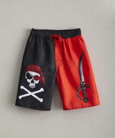 boys skull pirate board shorts - Let fun-loving pirates set sail in bold board shorts. With their skull-and-crossbones and cutlass graphics, they may appear fearsome, but these shorts are as cozy as it gets -- their mesh liner and elastic waist with drawstring keeps swimmers comfortable.