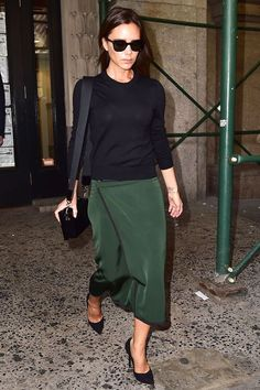 When You're A Minimalist, But Also A Spice Girl #refinery29 http://www.www.refinery29.com/2016/01/101670/victoria-beckham-street-style-pictures#slide-26 When in doubt, coordinate with the scaffolding....