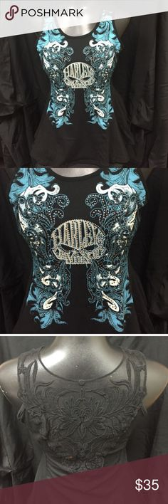 Bling Peplum Top Super cute bling peplum top with lace back! The color is beautiful on this top! **Please DO NOT purchase this listing, comment size below and I will make a separate listing for you. Harley-Davidson Tops Tank Tops
