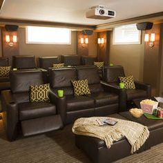 Media room - love the seating in front row and otttomans!