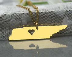 "Got it!  $12.99 - Tennessee Necklace - 16"" chain Platinum color Move the heart to over Chattanooga (she said she could do that!)  Also available in Sterling for $28.99."