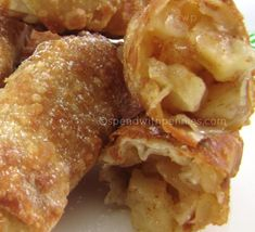 Apple Pie Egg Rolls ALSO, use flour tortillas, can fry or bake....I am baking and spreading some butter on before baking at 375 for 20 min if using cooked apples.....350 for 45 min if using raw apples