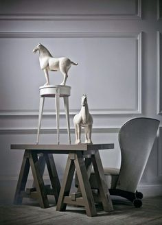 Love all the elements in this - horses are great, so is the chair & nice table by Kelly Hoppen