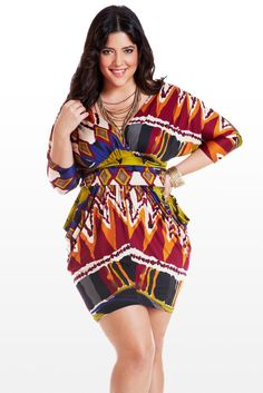 This energetic dress features a deep v-neckline, elbow length sleeves, cummerbund waist, and a tribal-meets-watercolor print. Stretchy fabric hugs curves nicely, draped skirt adds volume and style. Pair with a bold necklace and bracelet and you're set for an unforgettable date night.