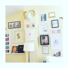 gallery wall with pink and gold accents