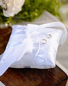 A crisp white ring pillow