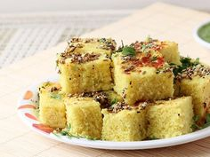This recipe is about making best soft and spongy khatta dhokla in traditional way. It is best enjoyed when served with lasun chutney and ground nut oil.